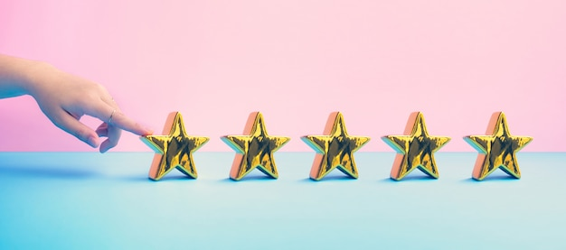 Customer review concepts with female finger and  five gold star