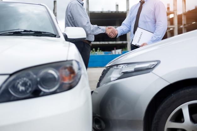 Customer shake hand with auto insurance agent