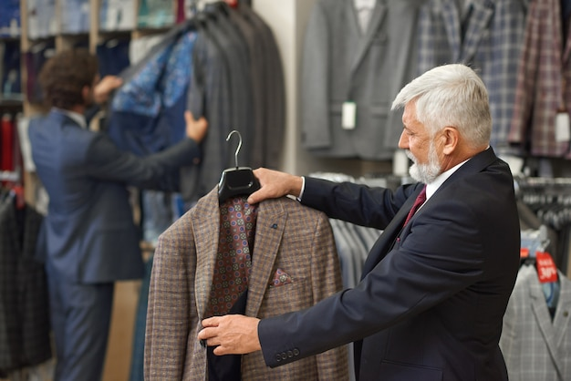 Customer thinking about buying checkerd brown jacket.