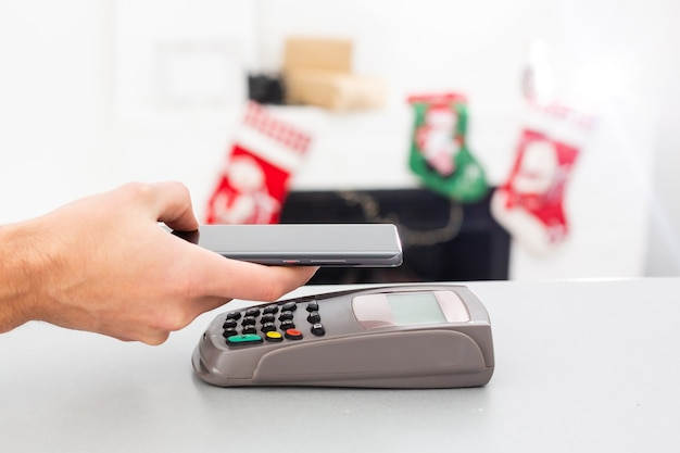 Customer using mobile phone to pay by nfc