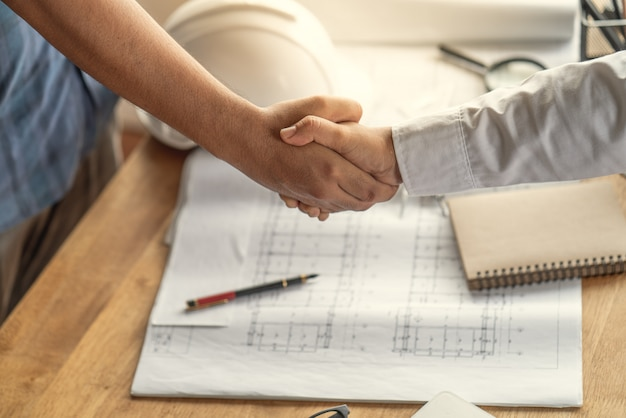Customers handshake agreement with the contractor for construction of houses