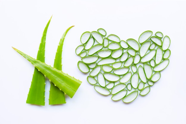 Cut aloe vera leaves with slices on white