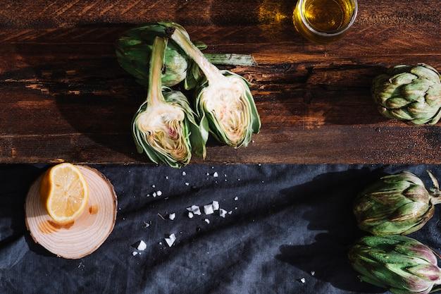Cut artichoke between oil and lemon