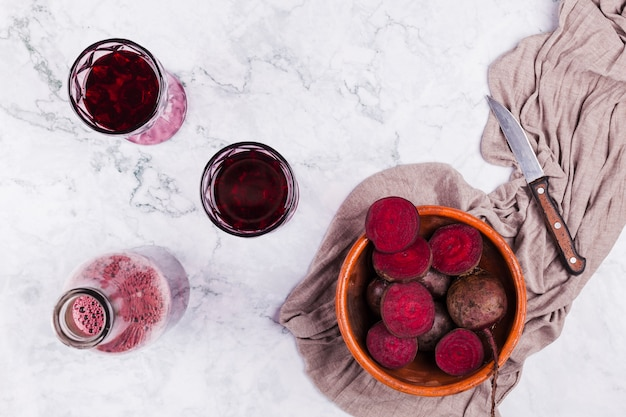 Cut beetroot with glasses of juice