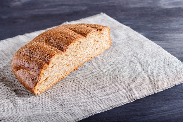 Cut buckwheat bread on linen napkin.