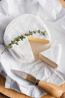 Cut camembert on table