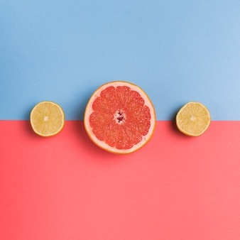 Cut citrus fruit on colorful background