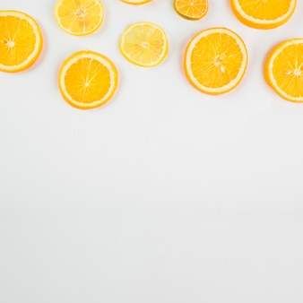 Cut citruses on white background