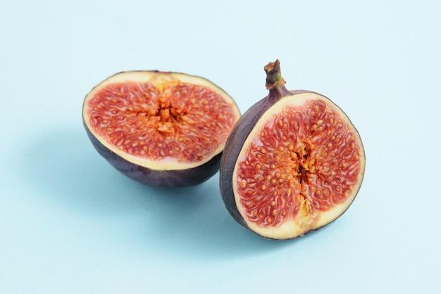 Cut figs on a blue