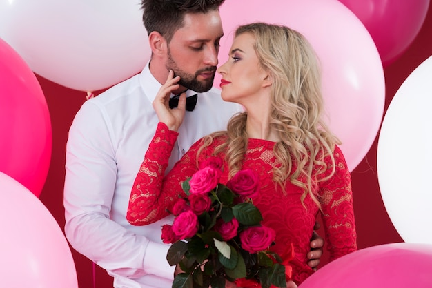 Cut flowers in hands of attractive woman