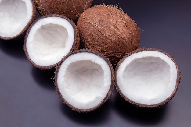 Cut fresh coconut on a dark