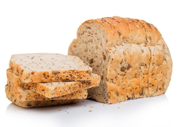 Cut of fresh loaf of seeded brown bread on white.