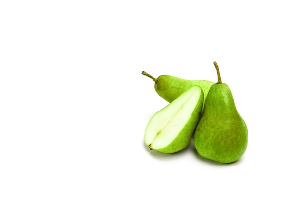 Cut green pear and slice on a white , compositionfruits. isolate.