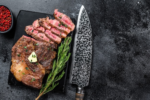 Cut grilled chuck eye roll beef meat steak on a marble board