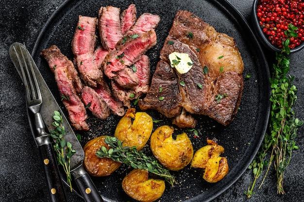 Cut grilled rib eye beef meat steak with potato