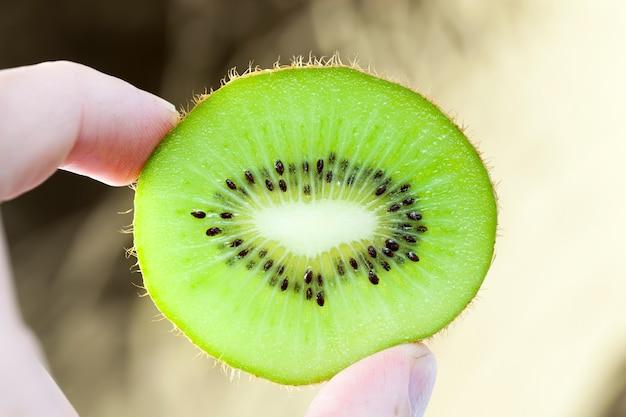 Cut half-green beautiful kiwi fruit, closeup of food product useful