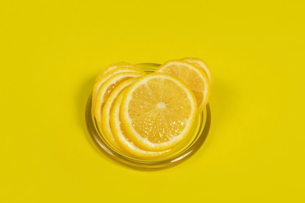 The cut lemon on a yellow surface