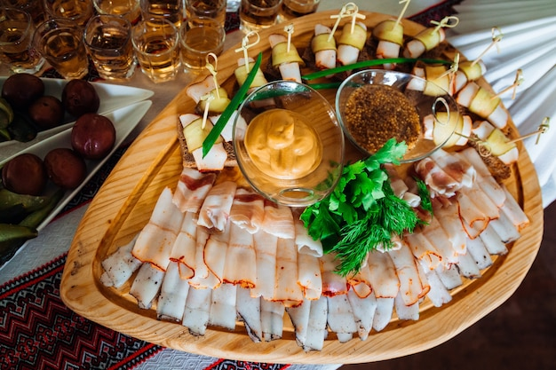 Cut meat lies on the original wooden dishes
