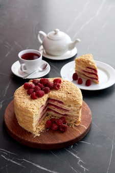 Cut mille-feuille, cake napoleon with raspberries jam