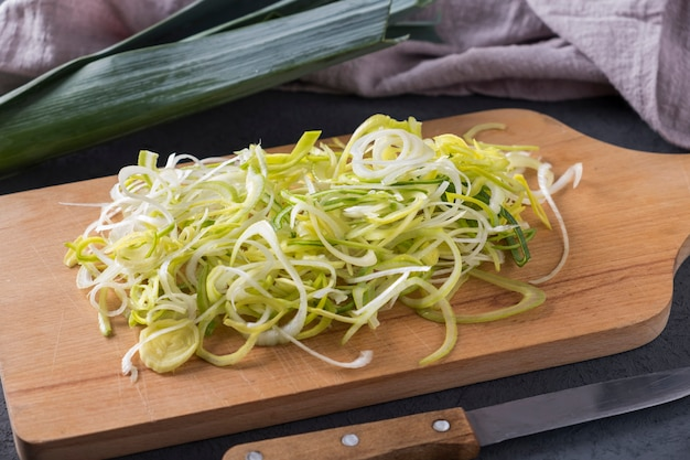 Cut onions on wooden cutting board. shallot onions on wooden cutting board