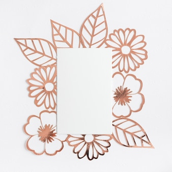 Cut out flower and leaves around the blank paper on white background