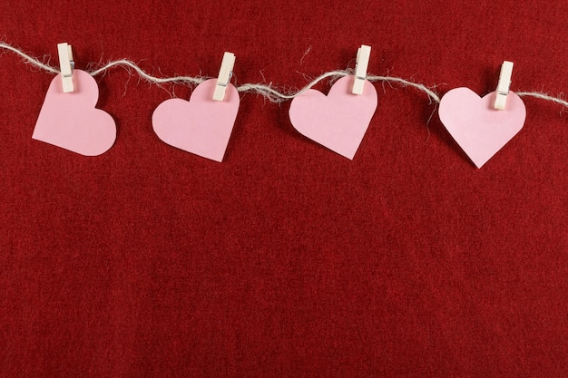 Cut out hearts on rope