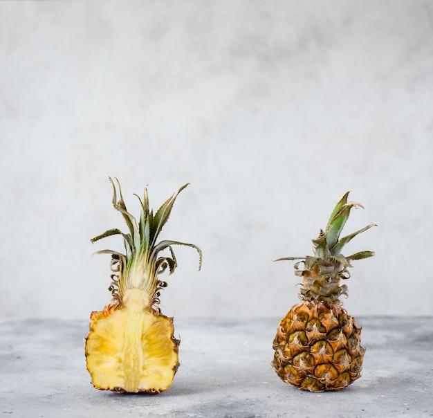 Cut pineapple, juicy ripe fruit. light gray background