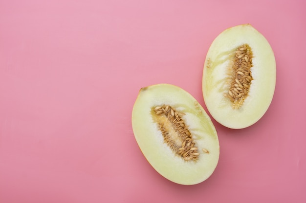 Cut ripe melon,  pink background. copy space.