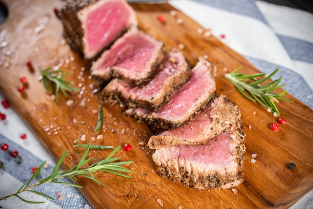 Cut roasted beef sirloin with rosemary and pepper