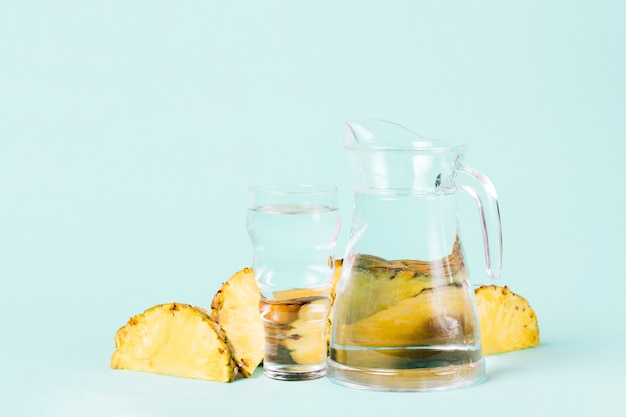Cut slices of pineapple with water jug