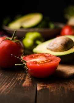 Cut tomato and avocado for salad