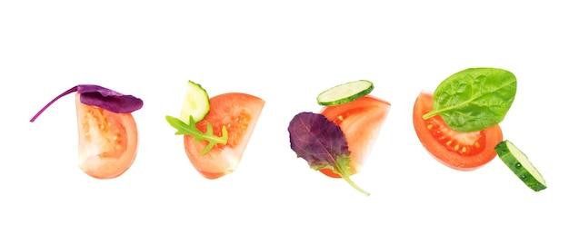 Нарезанные овощи для салата на белом фоне