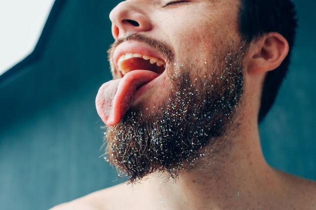 Cut view of bearded guy show tongue on picture. close up. health and oral care.
