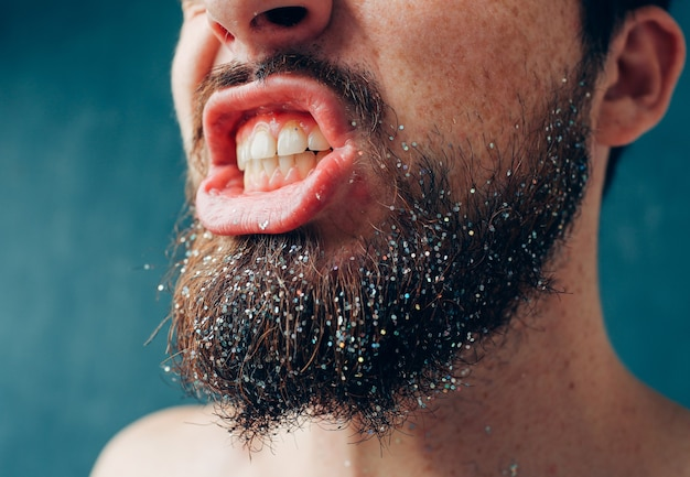 Cut view and close up of bearded male person show teeth. healthy good oral and dental care. close up of lips and low face part.