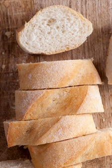 Cut white bread into pieces to use for sandwiches