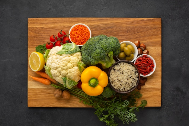 Cutboard with groceries on slate background