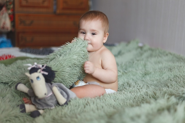 Cute adorable newborn baby of 3 months with diapers