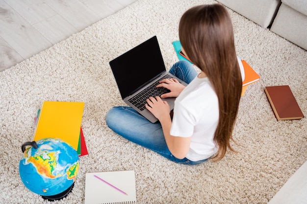 Cute adorable small girl education lesson time typing netbook