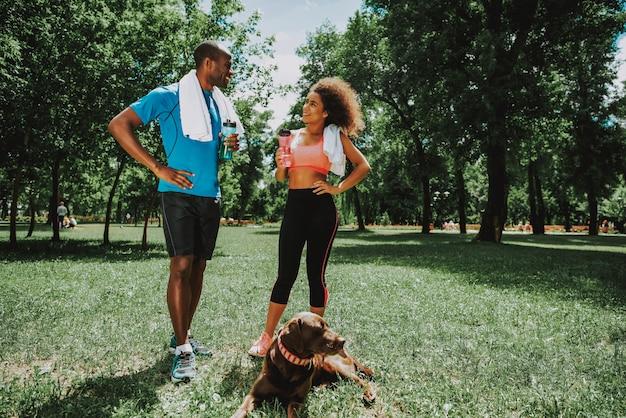 Cute african american couple in sportswear talking
