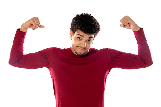 Cute african american man with afro hairstyle wearing a burgundy t-shirt isolated