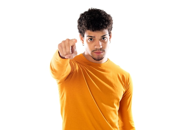 Cute african american man with afro hairstyle wearing a orange t-shirt isolated
