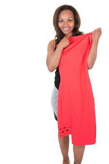 Cute african american woman choosing outfit dress