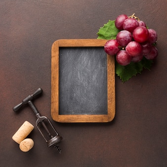Cute arrangement of grapes on blackboard