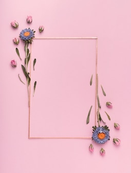 Cute arrangement of a vertical frame with flowers on pink background