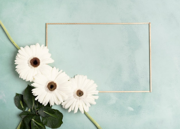 Cute arrangement of white fresh flowers and horizontal frame