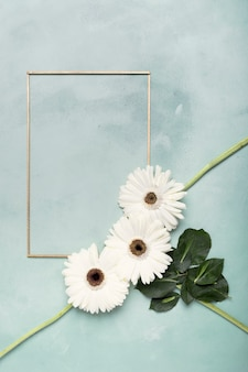 Cute arrangement of white fresh flowers and vertical frame