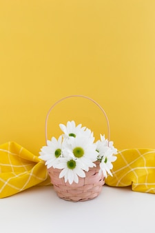 Cute arrangement with basket of daisies