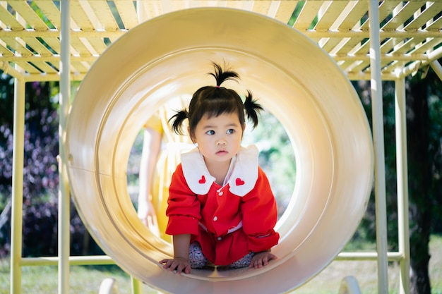 Cute asian baby playing at the playground