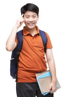 Cute asian child with school stationery on white .