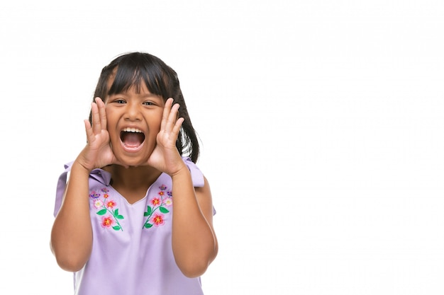 Cute asian dark little girl making a funny emotion on face .
